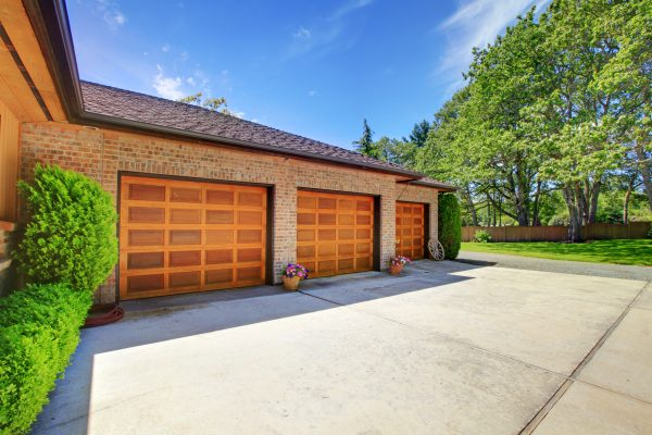 How to Select The Perfect Material For Your Custom Garage Door